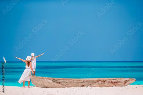 Fotografija Beautiful mother and daughter at Caribbean beach enjoying summer vacation