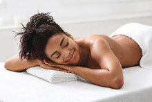Relaxed African American Woman...