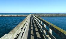 Wooden Bridge To Wave Breaker In Westhaven Cove