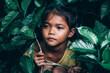 Leinwandbild Motiv An 8-year-old Thai poor girl is lovely in a homeless neighborhood.