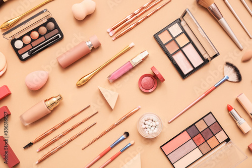 Obraz Set of makeup brushes with decorative cosmetics on color background - fototapety do salonu
