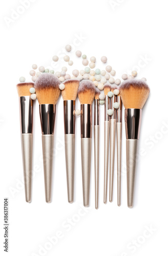Obraz Set of makeup brushes with powder pearls on white background - fototapety do salonu