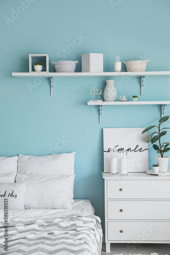 Obraz Interior of modern stylish bedroom with shelves - fototapety do salonu