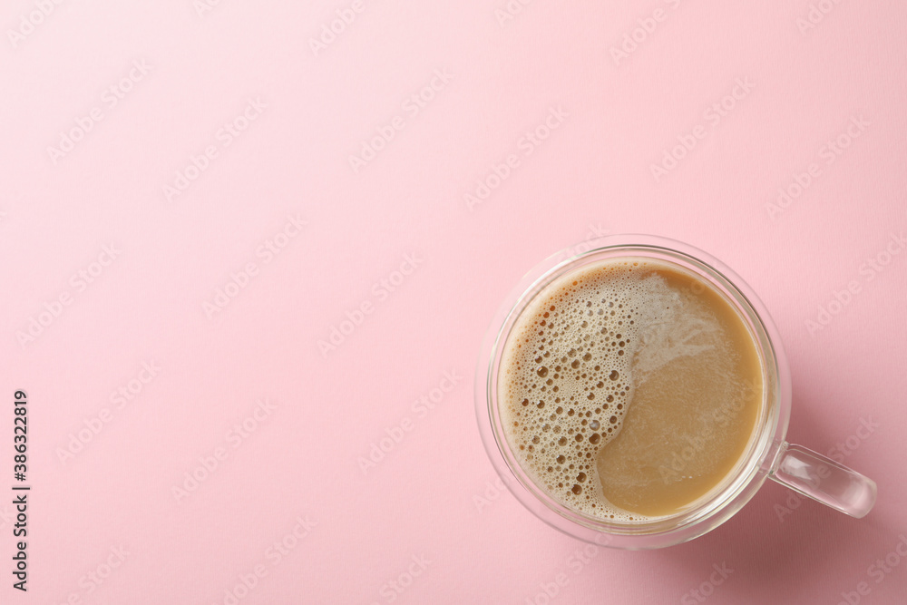 Fototapeta Cup of coffee on pink background, top view