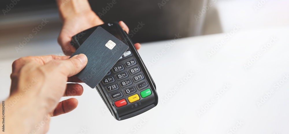 Fototapeta nfc contactless payment by credit card and pos terminal. copy space