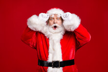 Photo Of Retire Old Man Grey Beard Take Off Hold Specs Open Mouth Afraid Forget Presents Home Children Wait Wear Santa Costume Belt Gloves Coat Spectacles Headwear Isolated Red Color Background