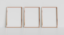 Three Golden Frames Leaning On White Floor In Interior Mockup. Template Of Pictures Framed On A Wall 3D Rendering