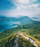 People walking on Footpath on a sharp mountain in Clear Water Bay, Sai Kung, Hong Kong. Hiking destination, clear weather in Autumn, Epic View
