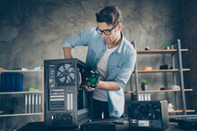 Portrait Of His He Nice Attractive Focused Busy Hardworking Professional Guy Geek Technician Repairing Hardware Detail Fixing Order At Modern Loft Industrial Home Office Work Place Station