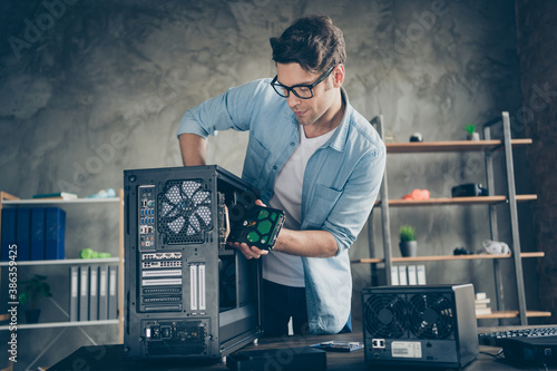 Obraz Portrait of his he nice attractive focused busy hardworking professional guy geek technician repairing hardware detail fixing order at modern loft industrial home office work place station - fototapety do salonu