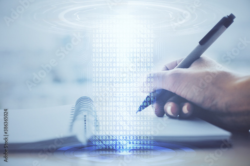 Tablou Canvas Double exposure of writing hands on background with data solution hologram on front