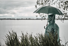 A Man In A Green Raincoat And ...