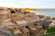 Sunny day in Tarragona Amphitheatre in Spain - A UNESCO World Heritage Site in summer.