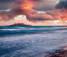 Dramatic Spring View Of Southernmost Point Of Sicily With Correnti Island, Italy, Europe. Stunning Sunrise On Mediterranean Sea. Active Tourism Concept Background.