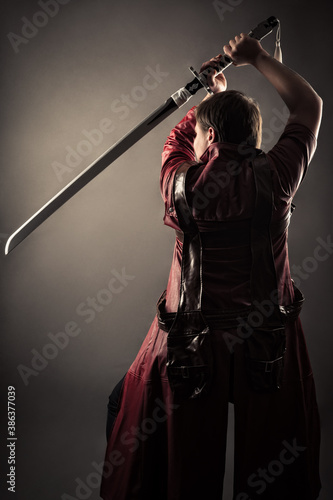 male warrior in cloak with sword Canvas Print