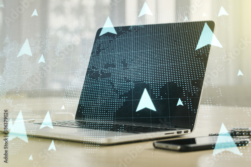 Creative concept of geolocations map on modern laptop background. GPS tracking and navigation concept. Multiexposure