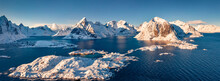 Panoramic View From Flying Drone Of Hamnoy, Sakrisoy And Reine Villeges - Most Popular Tourist Destination On Lofoten Island. Aerial Winter View Of Norway, Europe. Bright Sescape Of Norwegian Sea.