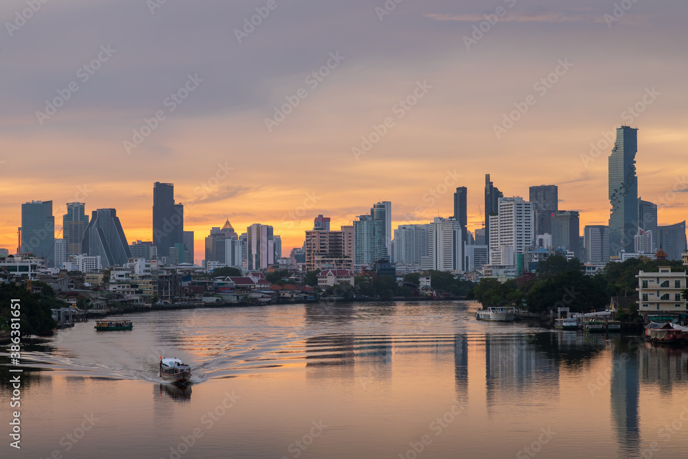 Fototapeta Bangkok city center financial business district, waterfront cityscape and Chao Phraya River during twilight before sunrise, Thailand