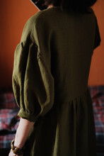Woman In Olive Linen Puff Slee...