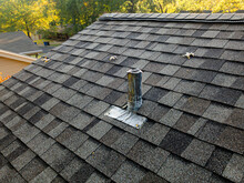 Metal Sewer Plumbing Ventilation Pipe On Shingled Roof - Exhaust Pipe