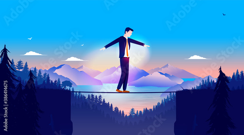 Fotografie, Obraz Business risk - Businessman balancing on rope in a risky challenge with landscape and mountains in background