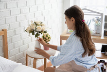 Woman Arranging Flower Decorat...