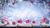 Ornament On Snowy Table With Garland Of Fir Branches - Abstract Christmas Background