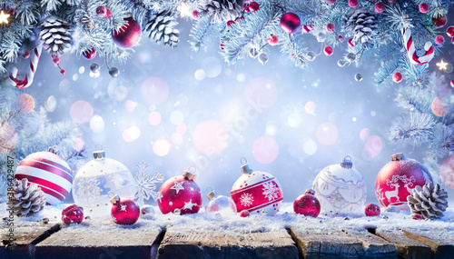 Ornament On Snowy Table With Garland Of Fir Branches - Abstract Christmas Background - 386429487