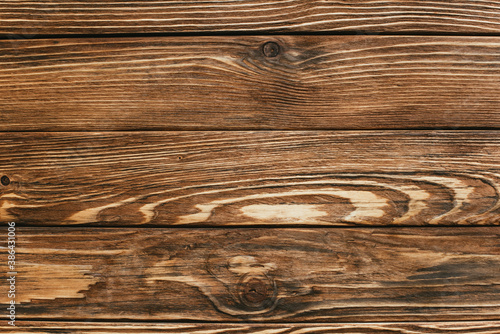 Plakaty brązowe  top-view-of-wooden-brown-rustic-background