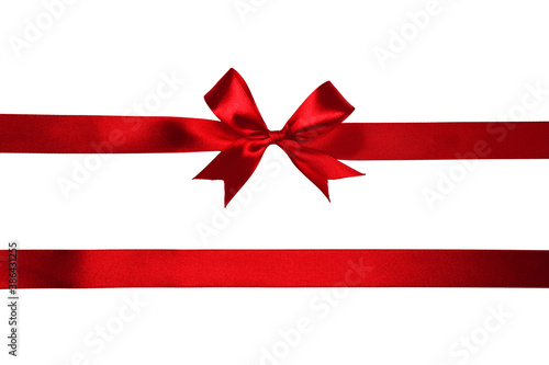 Obraz na plátně Red satin bow and ribbon isolated on white background