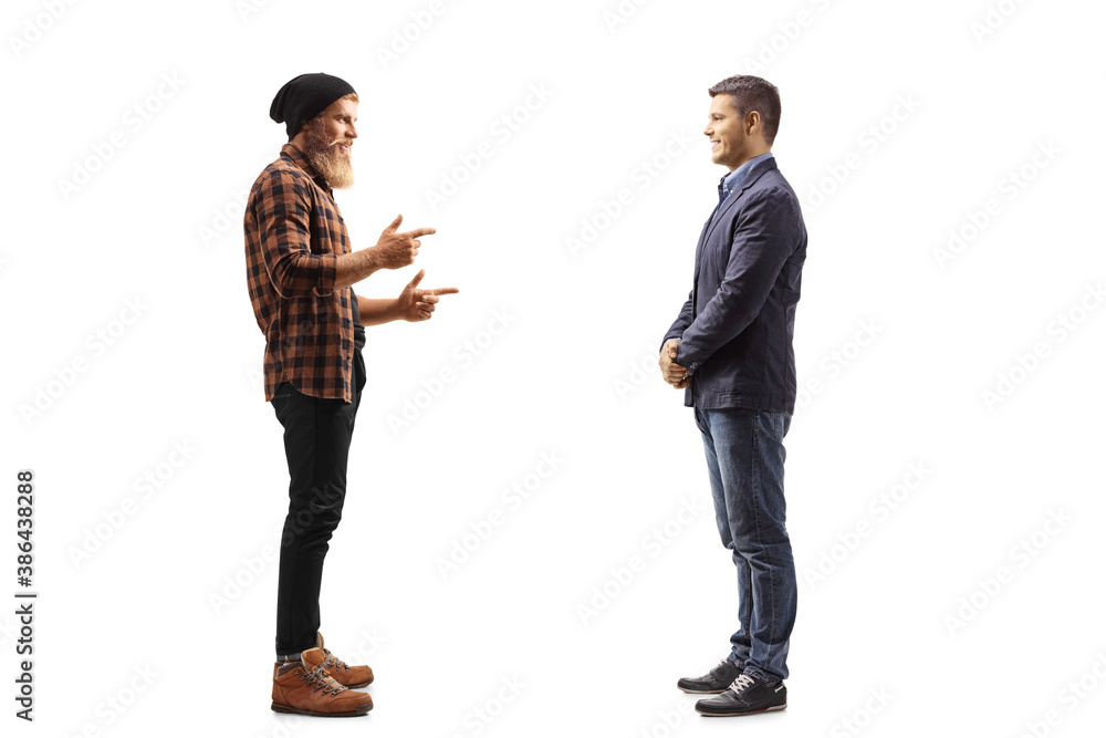 Fototapeta Full length profile shot of a bearded guy standing and talking to a man