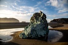 Large Rocks On A Sunny Beach