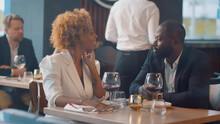 African Couple Enjoying Romantic Date In Restaurant.
