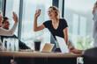Leinwandbild Motiv Business people high five in a meeting