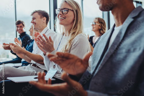 Business professionals applauding at a seminar - 386446626