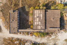 Aerial View Of Damaged And Abandoned House In Rural Area. Abandoned And Destroyed House.