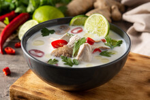 Traditional Thai Food Tom Kha Gai In Bowl On Wooden Table And Ingredients.