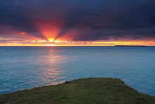 Amazing Orange Sunset Lighting Up Dark Clouds Looking Out From St. Anns Head Over Skokholm Island, South Pembrokeshire Coast, Wales, UK