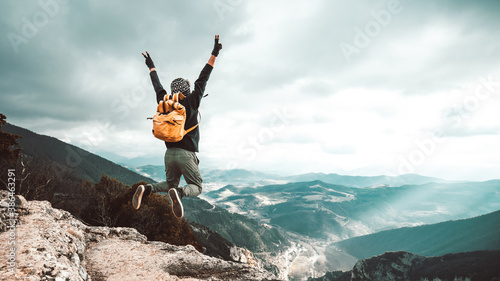 Canvas Print Successful hiker man jumping on the top of the mountain - Successful, business and sport concept