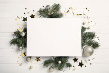 Flat Lay Composition With Christmas Decor And Blank Card On White Wooden Table. Space For Text