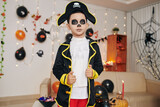 Portrait of serious preteen boy in pirate skeleton costume