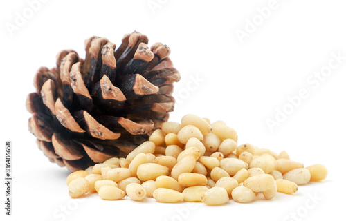 Pine nut heap and pine cone on a white background. Isolated Fototapet