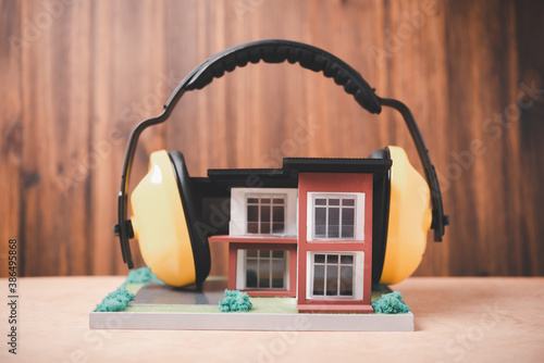 Obraz na plátně house is covered with headphones to reduce noise , Solving the problem of noise
