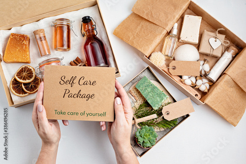Fototapeta Preparing self care package, seasonal gift box with plastic free zero waste cosmetics products obraz