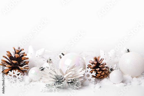 Silver and white Christmas balls and ornaments on white snow background Fotobehang