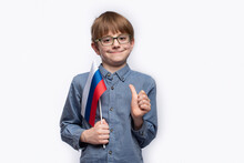 Boy-excellence Holds The Russian Flag And Shows Gesture Well Done. Portrait Isolated On White Background