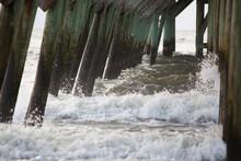 Waves Splashing Under A Fishin...