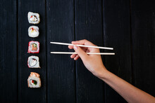 Female Hand Takes Chopsticks S...