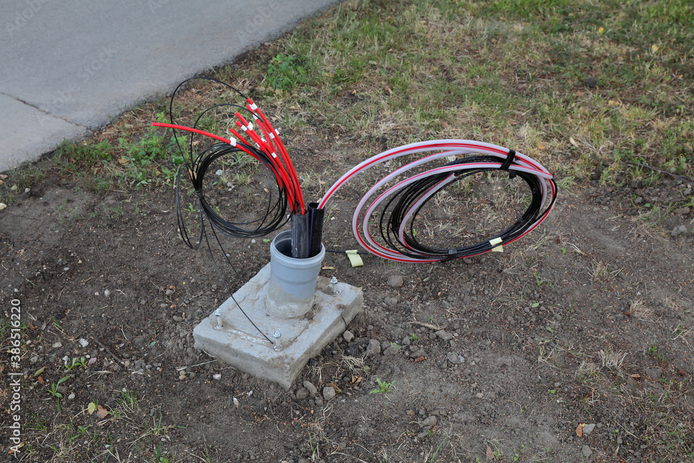 Fototapeta Optic fiber cables for internet and telephone installation, power lines installation at street
