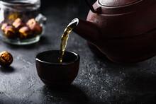 Pouring Ready Red Tea Into Tea...
